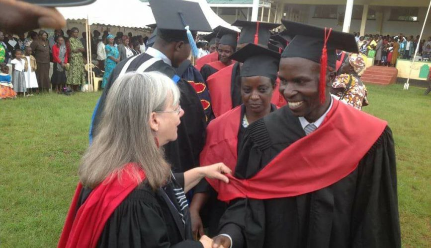 Founder of Neema Bible College congratulating student